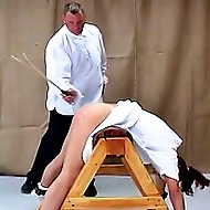 Girl in white dress gets caned again!