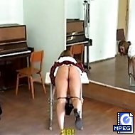 School girl in restraint and severely caned in the music room - hot welted cheeks