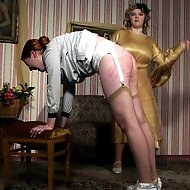 Severe domestic caning for pretty maid - bruised and striped buttocks